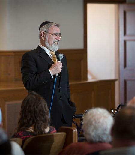 Rabbi Jonathan Sacks speaking to a crowd