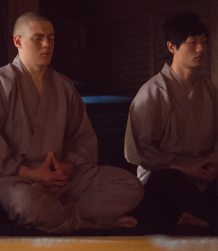 Cornell student meditating in Japanese temple